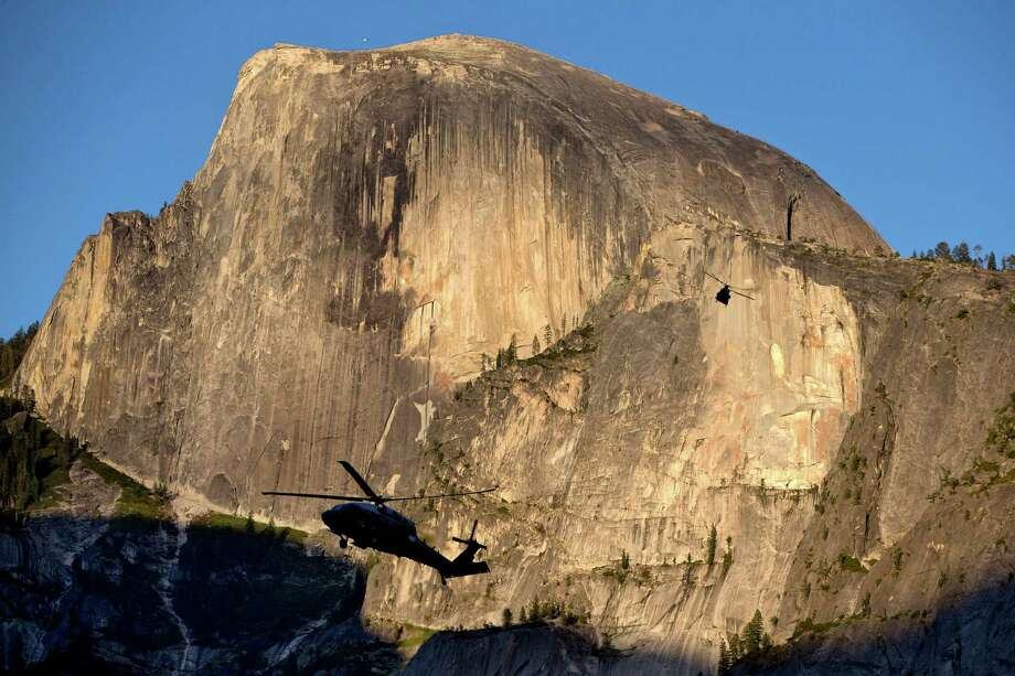 FILE - In this Friday, June 17, 2016, file photo, Marine One, foreground, carrying President Barack Obama, first lady Michelle Obama and daughters Malia Obama and Sasha Obama, and a support helicopter are silhouetted against the Half Dome rock formation at sunset as the first family arrives at Yosemite National Park, in Calif. In a new project with National Geographic, Obama becomes the first sitting U.S. president to project himself into virtual reality, in this case, a 360-degree representation of Yosemite National Park. The 11-minute VR video, narrated by Obama, is one part paean to the wonders of America's national parks and one part warning of the threat posed by climate change. Photo: Jacquelyn Martin, AP / AP