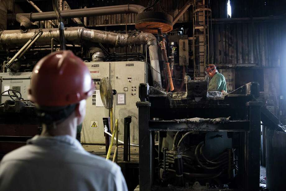A worker uses a magnet to release scrap metal into a furnace. An important category that serves as a proxy for business investment rose 1.6 percent in July, the best showing in this category in six months. The result could be a sign that business investment is starting to rebound following the big cutbacks earlier this year. Photo: Ty Wright /Bloomberg News / © 2016 Bloomberg Finance LP