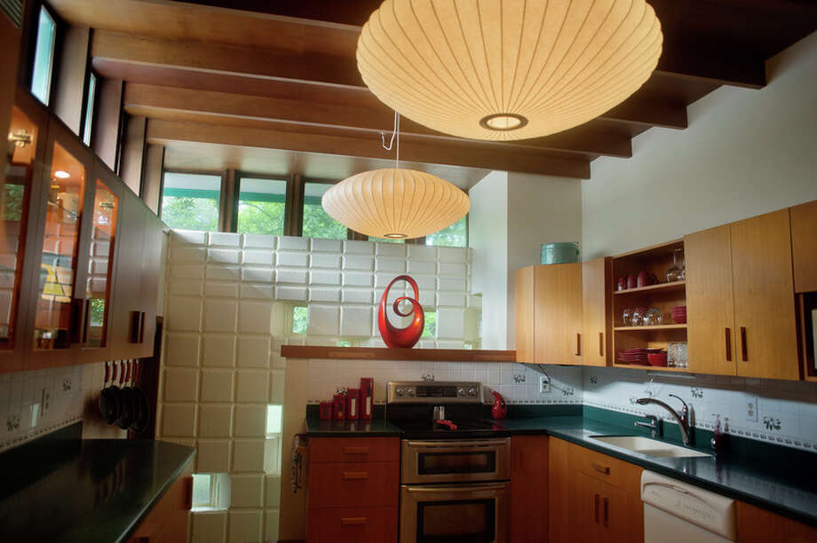 George Nelson bubble lamps hang in Jamie and Lance Rynearson's kitchen.