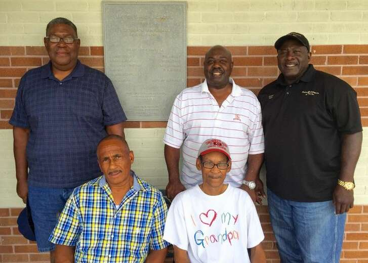 From left: Former Montgomery Lincoln High football players Dan Davis, Sherman Hamilton, Eddie Allen and Lewis Easley, joined by sponsor Arnette Easley, stand in front of a plaque dedicated to the old high school.