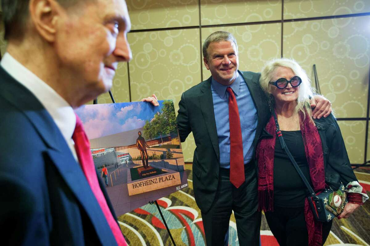 Fred Hofheinz, left, Tilman Fertitta and Dene Hofheinz pose for a photo by a rendering of the proposed Hofheinz Plaza following a news conference announcing a $20 million gift to the University of Houston to renovate the UH basketball arena on Thursday, Aug. 25, 2016, in Houston. Fertitta's gift to the university is the largest ever individual donation to UH Athletics. Following the renovation, scheduled for completion for the 2018-19 basketball season, the arena, now known as Hofheinz Pavilion, will be renamed the Fertitta Center.