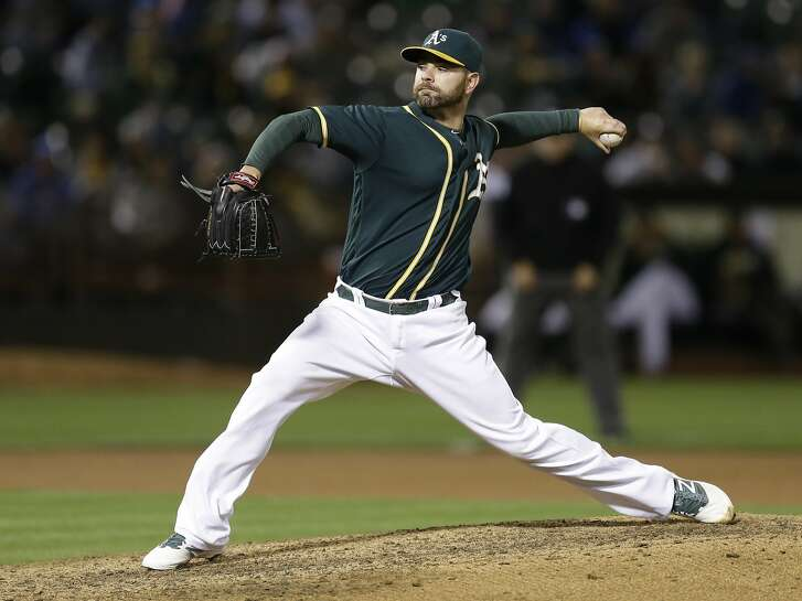 Oakland Athletics pitcher Marc Rzepczynski works against the Chicago Cubs during the ninth inning of a baseball game Friday, Aug. 5, 2016, in Oakland, Calif. The Cubs won 7-2. (AP Photo/Ben Margot)