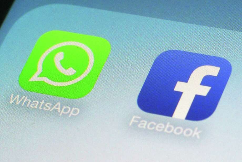 Global messaging service WhatsApp says it will start sharing the phone numbers of its users with Facebook, its parent company. That means WhatsApp users could soon start seeing more targeted ads on Facebook, although not on the messaging service itself. Photo: Associated Press /File Photo / Copyright 2016 The Associated Press. All rights reserved. This material may not be published, broadcast, rewritten or redistribu