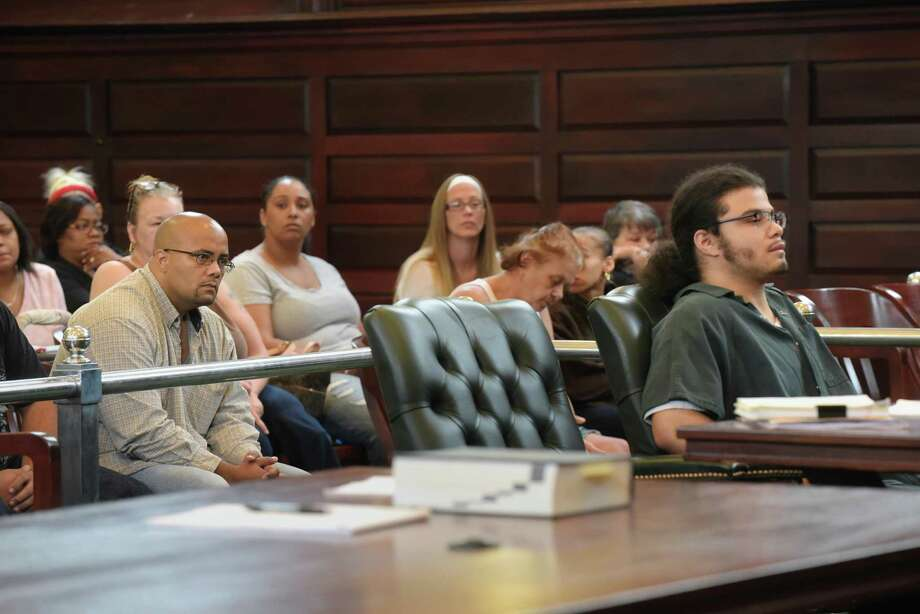 Nate Milligan, left, the father of murder victim, Vanessa Milligan, looks at Gabriel Vega, far right, who was convicted of the murder of Milligan and her unborn daughter, during the sentencing of Vega at Rensselaer County Court on Thursday, Aug. 25, 2016, in Troy, N.Y.  (Paul Buckowski / Times Union) Photo: PAUL BUCKOWSKI / 20037707A