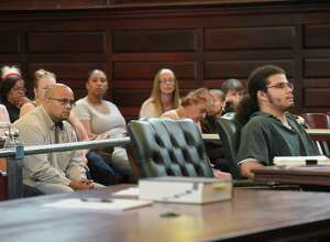 Nate Milligan, left, the father of murder victim, Vanessa Milligan, looks at Gabriel Vega, far right, who was convicted of the murder of Milligan and her unborn daughter, during the sentencing of Vega at Rensselaer County Court on Thursday, Aug. 25, 2016, in Troy, N.Y.  (Paul Buckowski / Times Union)