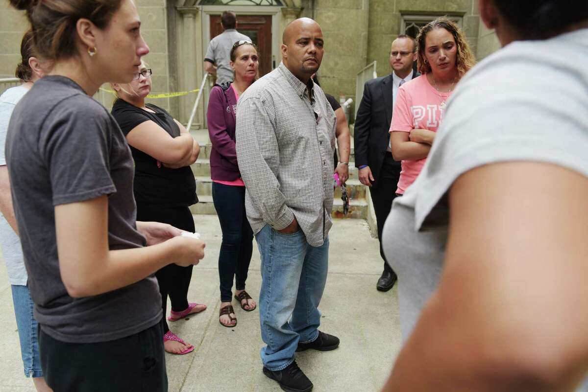 Nate Milligan, center, the father of murder victim, Vanessa Milligan, stands outside Rensselaer County Court with family and friends following the sentencing of Gabriel Vega for the killing of Vanessa Milligan and her unborn daughter on Thursday, Aug. 25, 2016, in Troy, N.Y. (Paul Buckowski / Times Union)