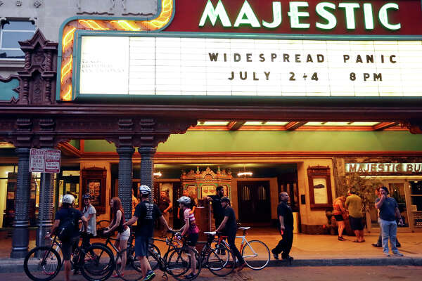 Cyclist participating in the Thursday Night Social Skoach stop at the Majestic Theatre Thursday July 2, 2015.