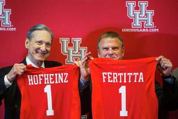 Roy Hofheinz, left, and Tilman Fertitta hold up University of Houston basketball jerseys during a news conference announcing Fertitta's $20 million gift to UH to renovate the school's basketball arena on Thursday, Aug. 25, 2016, in Houston.  Fertitta's gift to the university is the largest ever individual donation to UH Athletics. Following the renovation, scheduled for completion for the 2018-19 basketball season, the arena, now known as Hofheinz Pavilion, will be renamed the Fertitta Center.  ( Brett Coomer / Houston Chronicle )