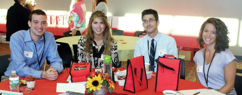 Alexander Amaru, from left, Olivia Patrizzi, Brennan McCormack and Samantha Bachman gathered at New Canaan's new teacher orientation at New Canaan High School on Wednesday. Photo: Erin Kayata / Hearst Connecticut Media / New Canaan News