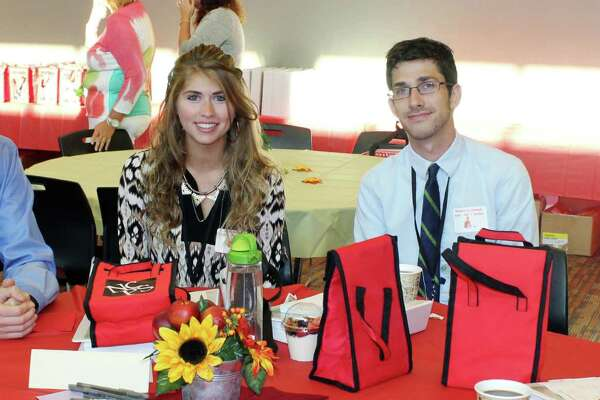 Alexander Amaru, from left, Olivia Patrizzi, Brennan McCormack and Samantha Bachman gathered at New Canaan's new teacher orientation at New Canaan High School on Wednesday.