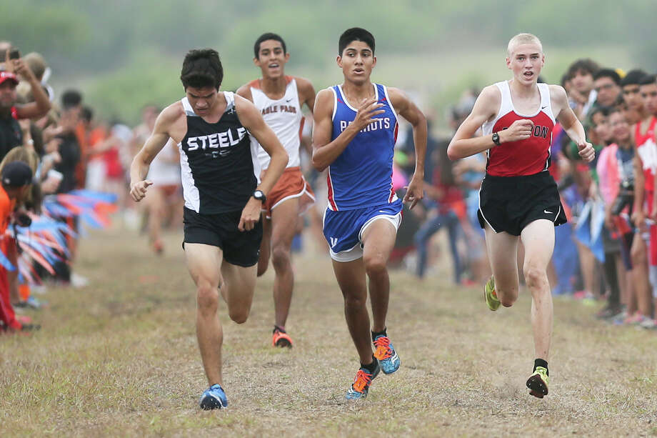 Steele's Garett Cortez (front, fom left), Mission Veterans Memorial's G.J. Reyna and New Braunfels Canyon's Sam Worley race towards the finish line of the Gold Boys 5K during the UTSA Ricardo Romo Classic cross country meet at the National Shooting Complex on Sept. 20, 2014. Photo: Marvin Pfeiffer /San Antonio Express-News / Express-News 2014