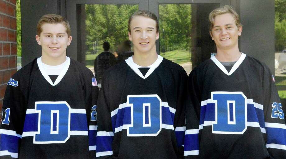The Darien High School boys hockey team is holding its annual car wash at the Depot on Saturday, Sept. 10, from 10 a.m. to 2 p.m. Each car costs $10 and T-shirts will also be available for sale. From left are 2016-17 Darien hockey captains Max Romeyn, Harry Congdon and Tom Sulger. Photo: Dana Sulger / Contributed Photo