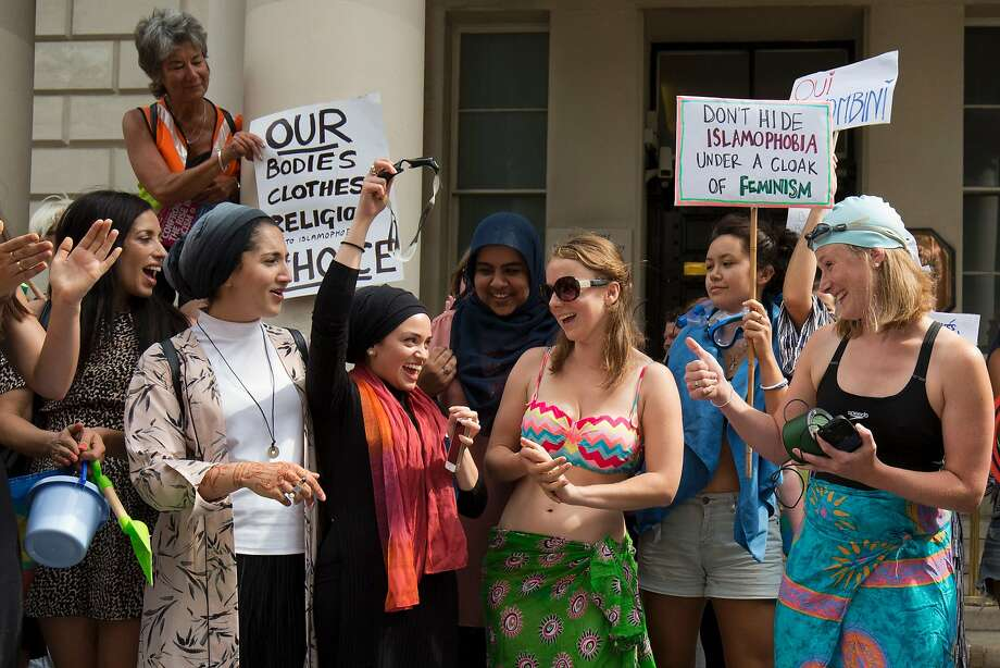 Protesters, some dressed in beachwear, gather at the French Embassy in London. Photo: JUSTIN TALLIS, AFP/Getty Images