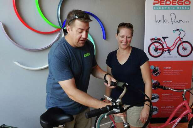 Mike and Jen Heslin on Aug. 25, 2016 at their new Pedego Electric Bikes store at 50 Water St. in Norwalk, Conn.