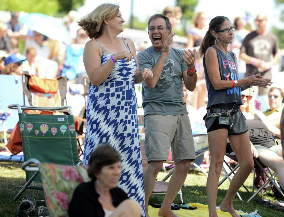 Friends Josie Hauer, of Bridgeport, Jim Lancaster, of Westport, and Anna Piekarski, of Fairfield, dance last year as Relative Souls performs during the Blues,Views & BBQ Festival in Westport. This year's festival will be Saturday and Sunday, Sept. 3 and 4. Photo: File Photo / Connecticut Post