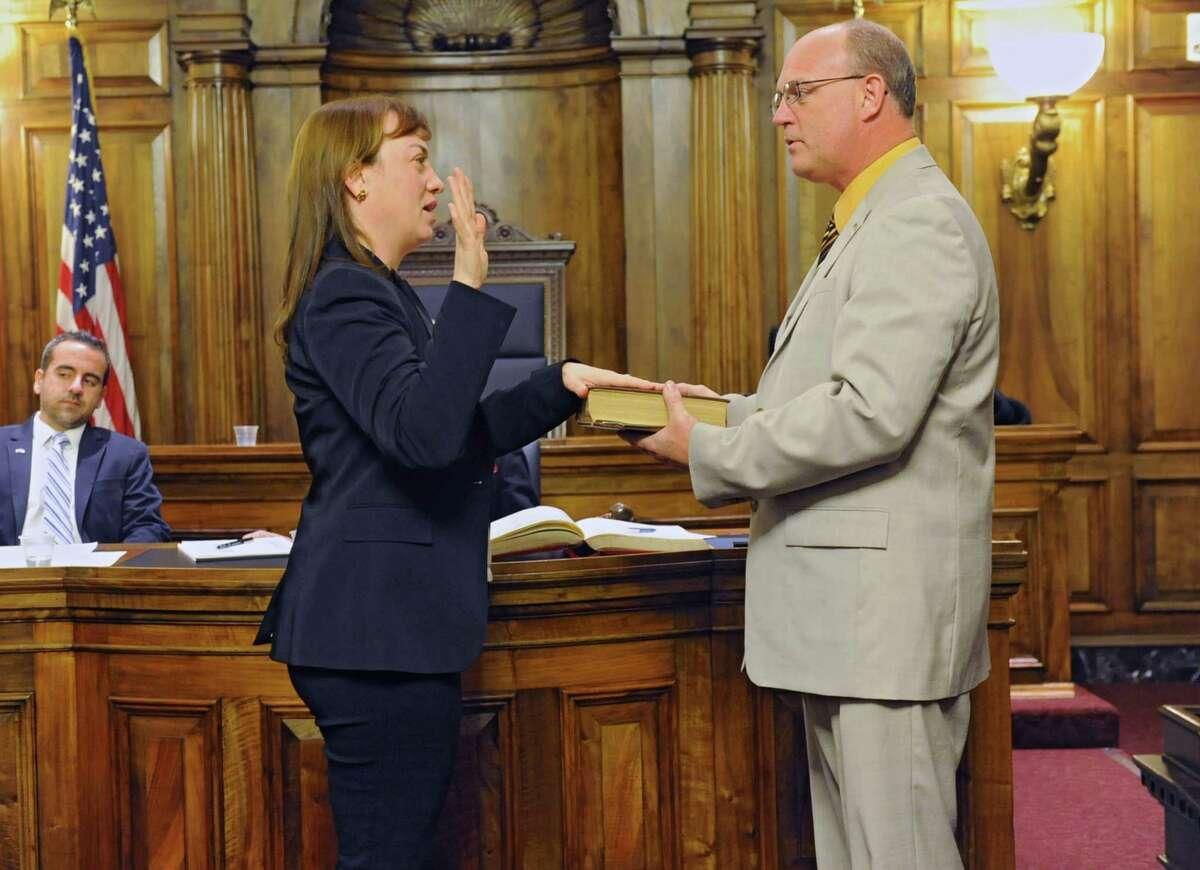 Alison McLean Lane is sworn in as Albany County Legislator by Albany County Clerk Bruce Hidley during an Albany County Legislature meeting at the Albany County Courthouse on Monday, Jan. 6, 2014 in Albany, N.Y. (Lori Van Buren / Times Union)