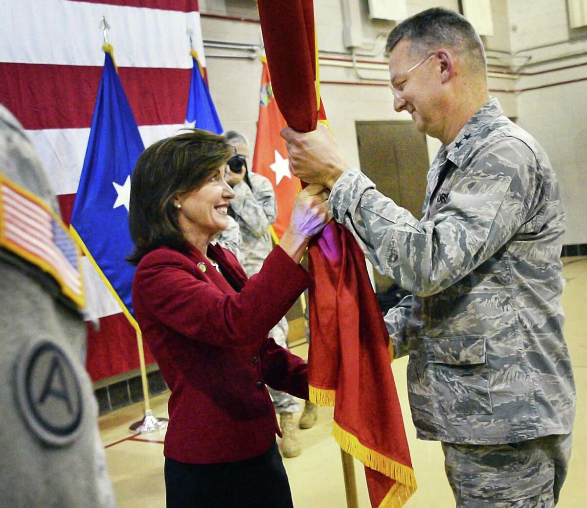 Lieutenant Governor Kathy Hochul, left, participates in the traditional flag-passing ceremony as Major General Anthony German takes over as the 53rd Adjutant General of New York in a ceremony at the NYS Div. of Military and Naval Affairs Thursday April 7, 2016 in Colonie, NY. (John Carl D'Annibale / Times Union)