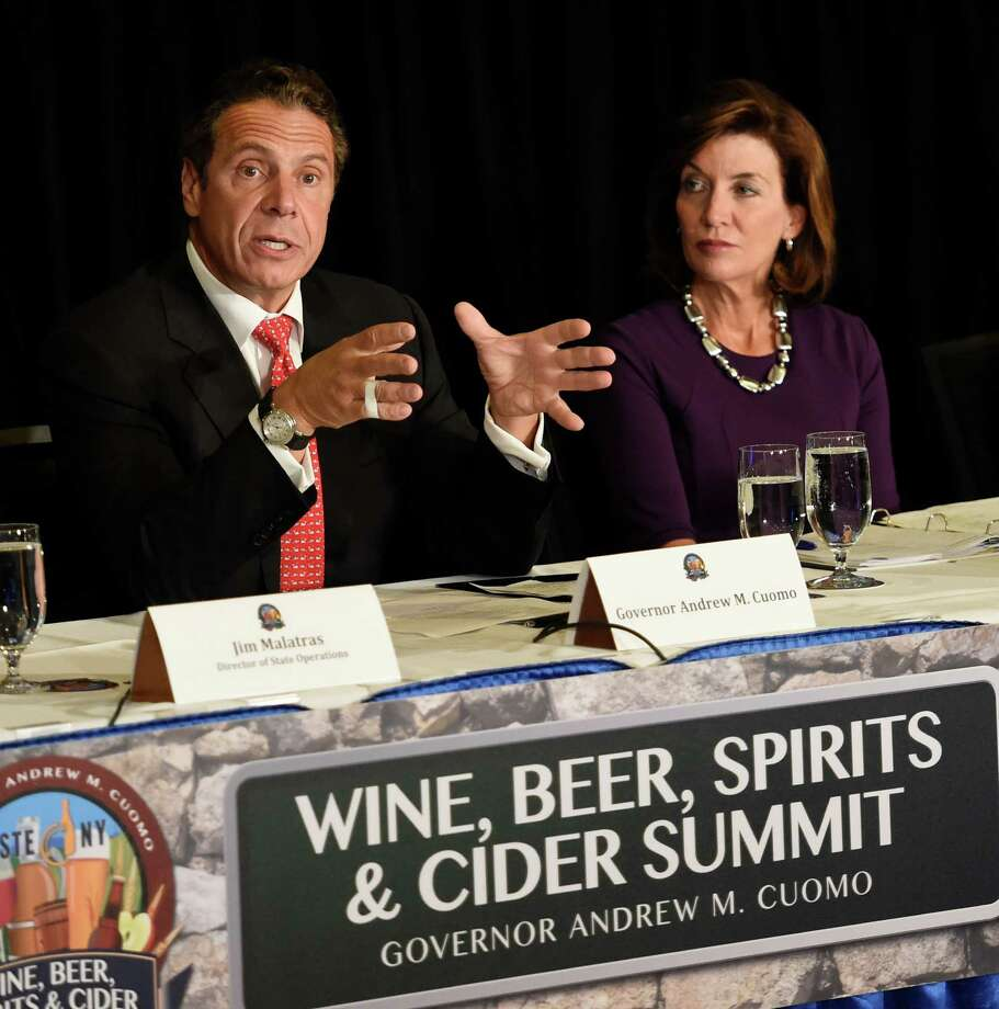 Governor Andrew Cuomo, left,  chairs the Beer, Wine, Spirits and Cider Summit held in the Hart Lounge at the Empire State Plaza Oct. 7, 2015 in Albany, N.Y.  Joining the Governor is Lt. Governor Kathy Hochul.   (Skip Dickstein/Times Union) Photo: SKIP DICKSTEIN / 10033665A