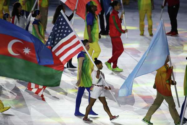 Simone Biles carries in the U.S. flag on Sunday, Aug. 21, 2016 at the Rio 2016 Closing Ceremony at Maracan in Brazil. (Robert Gauthier/Los Angeles Times/TNS)