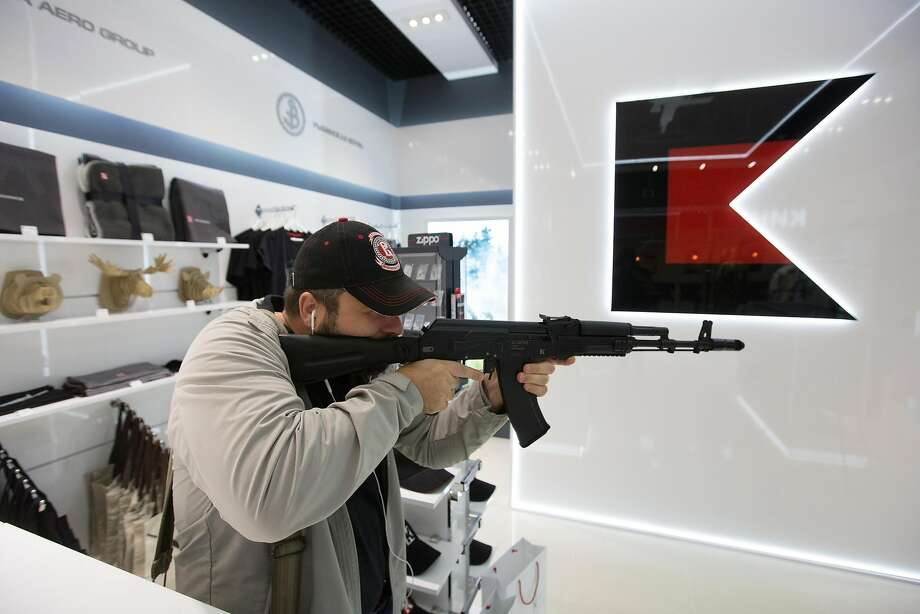 A customer tries out a replica Kalashnikov AK-47 assault rifle inside the Kalashnikov Concern JSC store at Sheremetyevo airport in Moscow, Russia, on Thursday, Aug. 25, 2016. The Russian gunmaker plans to open 60 stores selling Kalashnikov-branded souvenir fashion clothing, accessories and replica weapons. Photographer: Andrey Rudakov/Bloomberg Photo: Andrey Rudakov, Bloomberg