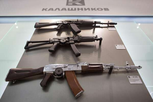 Replica assault rifles including the AK-47 assault rifle, below, sit on a display wall inside the Kalashnikov Concern JSC store at Sheremetyevo airport in Moscow, Russia, on Thursday, Aug. 25, 2016. The Russian gunmaker plans to open 60 stores selling Kalashnikov-branded souvenir fashion clothing, accessories and replica weapons. Photographer: Andrey Rudakov/Bloomberg