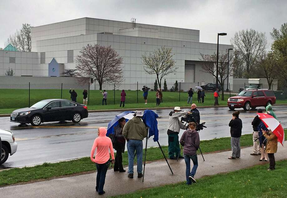FILE - In this April 21, 2016 file photo, people stand outside the entertainer Prince's Paisley Park compound in Chanhassen, Minn. Paisley Park, the private estate and production complex of the late rock superstar Prince, will open for public tours starting Oct. 6. (Jim Gehrz/Star Tribune via AP, File) Photo: Jim Gehrz, Associated Press