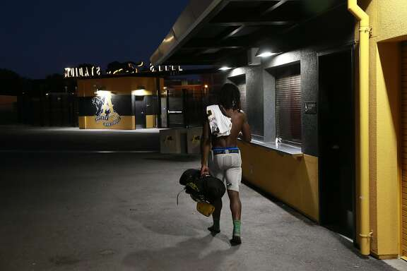 Antioch High School star football player Najee Harris heads for the locker room after  practice in Antioch, California, on Tues. Aug. 9, 2016.
