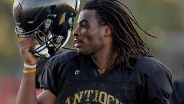 Antioch High School star football player Najee Harris works out during practice in Antioch, California, on Tues. Aug. 9, 2016.