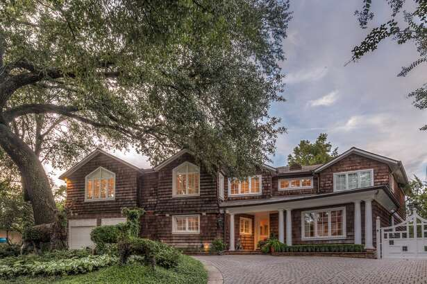 Front Exterior: Exquisite River Oaks home with cozy cottage appeal provides a circular drive guest entrance into a home of both refined & casual elegance. It was extensively renovated in 2004-2005 (O. Russell Worley, AIA/Mel Lowrance Design).