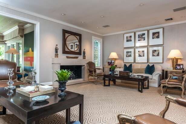 Formal Living Room:  The formal living room is the entry point into this one-of-a-kind home. This formal room has art display, art lighting & custom design. Gas fireplace, stone mantle & surround and crown molding accents create an elegant first impression.