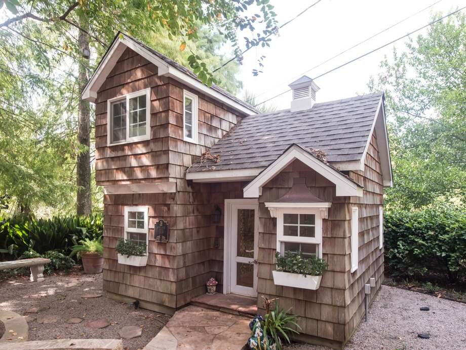 Playhouse 1:  This adorable custom playhouse was designed by La Petite Maison (Al Mowher of Denver) and interiors by J. Randall Powers  The 2-story hose has hardwood floors, faux fireplace and vaulted ceilings. Photo: Patrick Bertolino