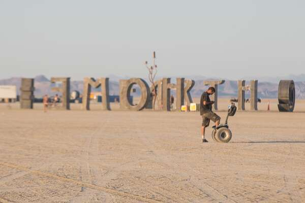 Artists and members of the Burning Man collective are busy erecting the temporary community known as Black Rock City and setting up art installations in the Black Rock Desert in Nevada.