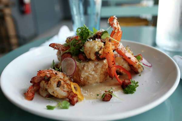 A serving of grits is laced with shrimp, gravy, jalapeños, ham and Parmesan cheese and then deep fried to resemble a big crabcake.