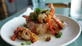Deep fried grits laced with shrimp, gravy, jalapeño, ham and parmesan cheese add a different twist on a classic shrimp and grits.