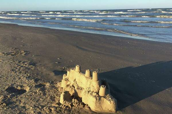 A sandcastle shaped like a ship is abandoned on the beach at the Padre Island National Seashore.