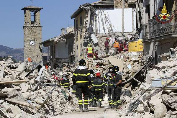 Rescuers work amid collapsed building in Amatrice, central Italy, Thursday, Aug. 25, 2016. Rescue crews raced against time Thursday looking for survivors from the earthquake that leveled three towns in central Italy and Italy once again anguished over trying to secure its medieval communities built on seismic lands. (Italian Firefighters Vigili del Fuoco via AP)