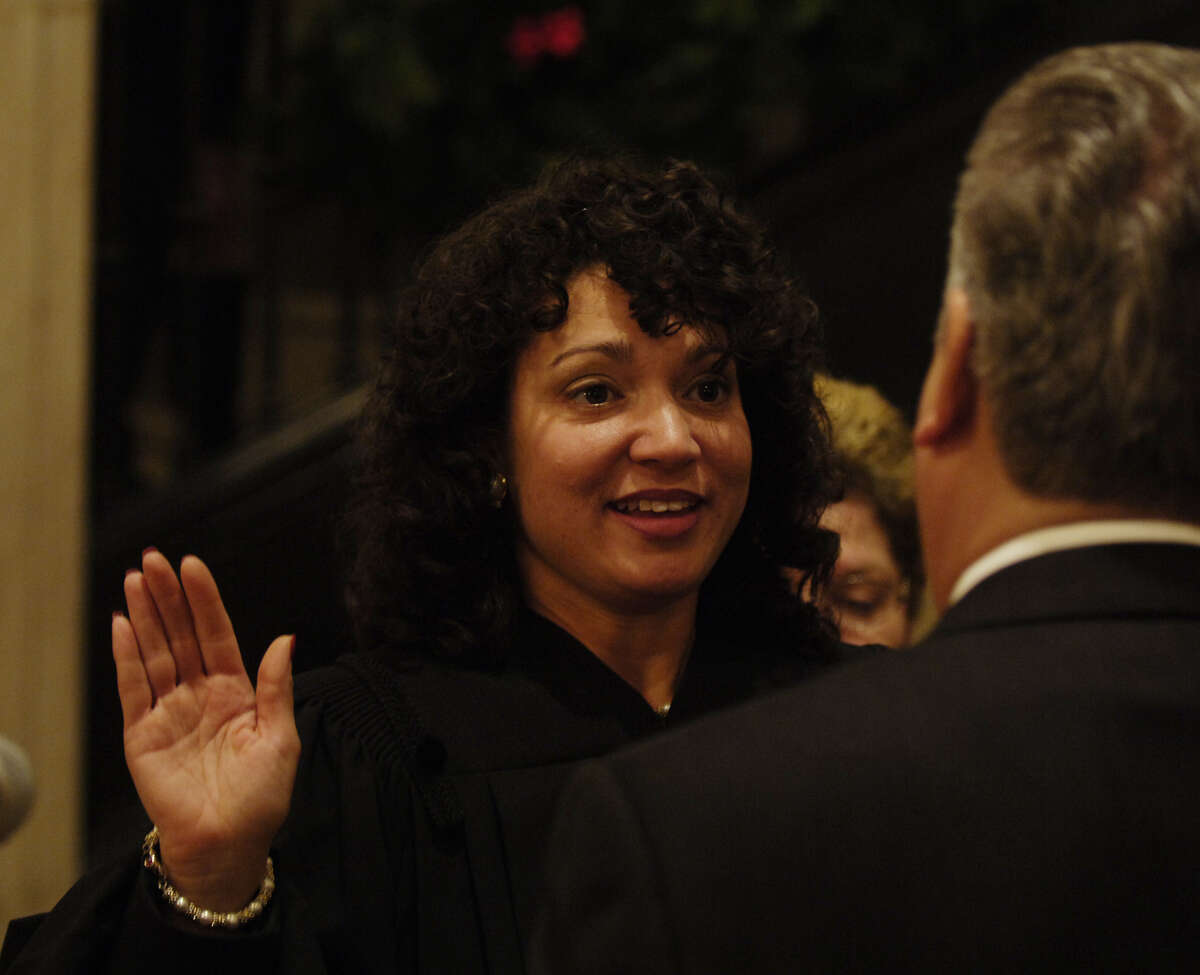 TIMES UNION STAFF PHOTO BY SKIP DICKSTEIN - Judge Helena Heath-Roland takes the oath of office of City Court Judge of Albany, New York in The Albany City Hall Rotunda Friday December 30, 2005 from Albany Mayor Jerry Jennings.