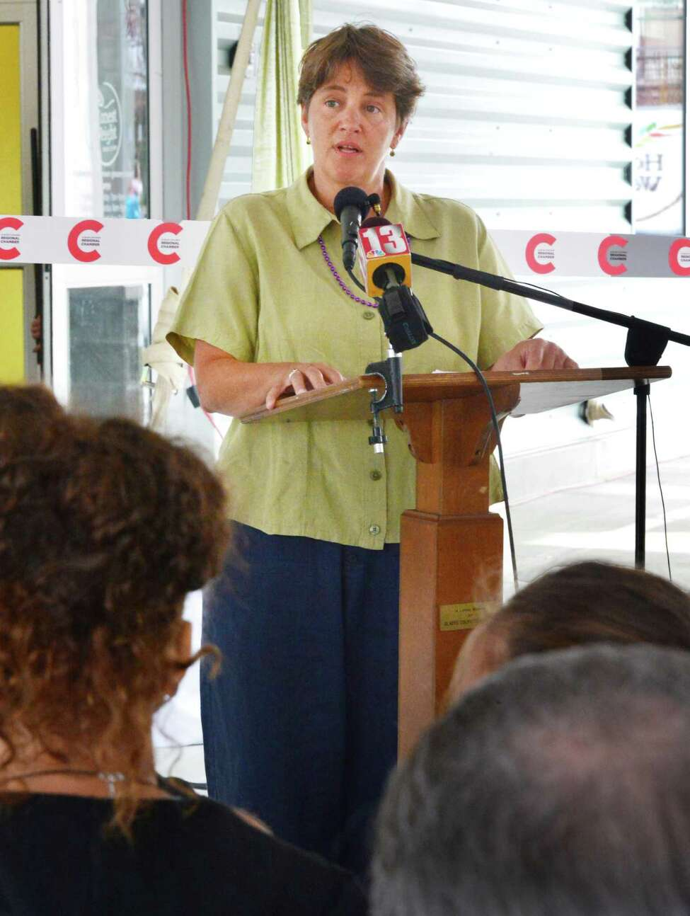 HWFC board president Lynne Lekakis speaks during grand opening ceremonies for Honest Weight Co-Op's new store on Watervliet Ave. Thursday Aug. 8, 2013, in Albany, NY. (John Carl D'Annibale / Times Union)