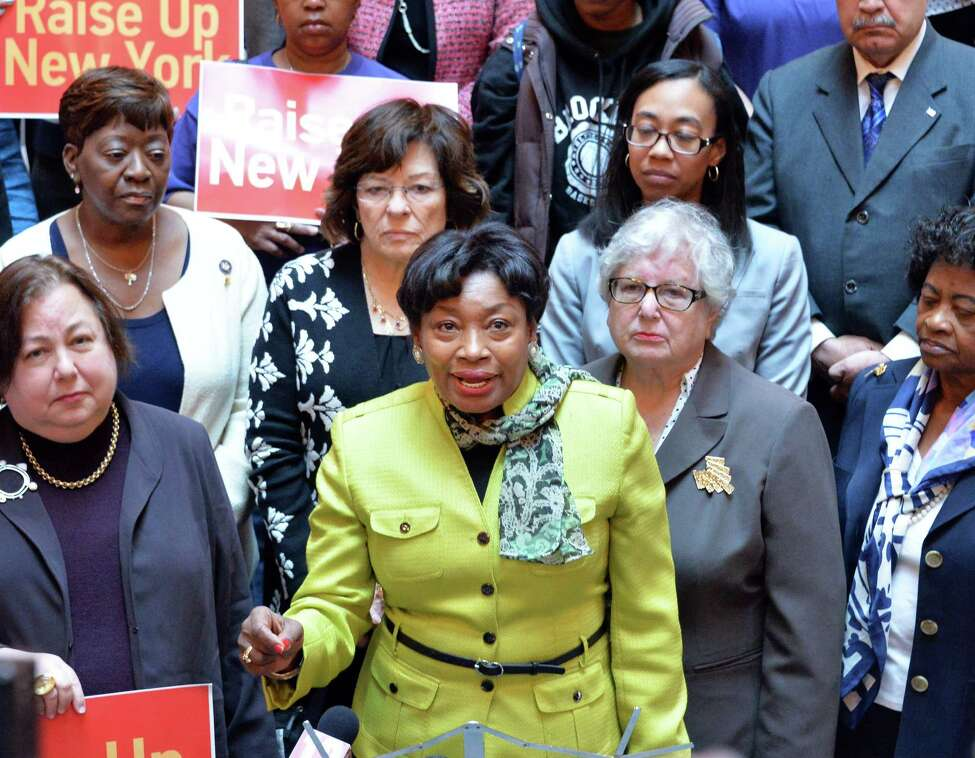 NYS Senate Democratic Leader Andrea Stewart-Cousins, center, joins a group of prominent women leaders to demand support for legislation allowing cities and counties to raise wages above the state's minimum wage Wednesday April 30, 2014, during a demonstration at the Capitol in Albany, N.Y. (John Carl D'Annibale / Times Union archive)