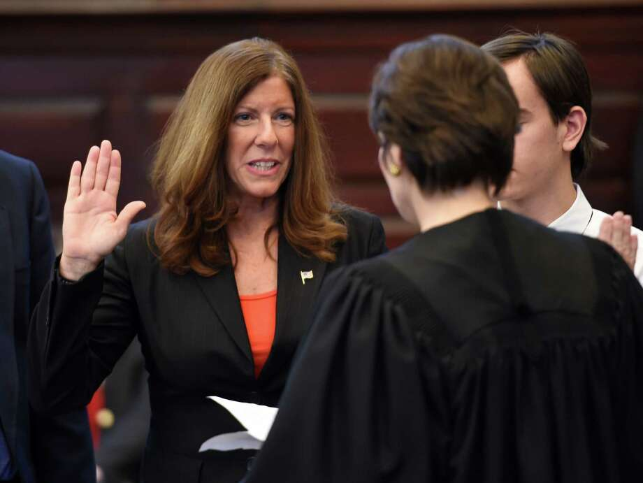 Carmella Mantello is sworn in as the new President of the Troy City Council during the swearing in of elected officials of the Republican Party on Jan. 1, 2016, at the Rensselaer County Courthouse in Troy, N.Y. (Skip Dickstein/Times Union archive) Photo: SKIP DICKSTEIN / 10034815A