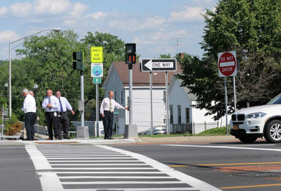 New York State Department of Transportation Region Director Sam Zhou, center, leads a group of officials across 787 using a new pedestrian crossing light on Tuesday July 5, 2016 in Cohoes, N.Y. (Michael P. Farrell/Times Union) Photo: Michael P. Farrell / 20037236A