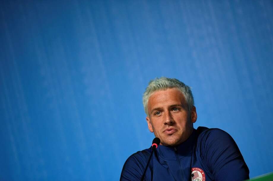 "(FILES) This file photo taken on August 03, 2016 shows US swimmer Ryan Lochte holding a press conference in Rio de Janeiro, two days ahead of the opening ceremony of the Rio 2016 Olympic Games. Star American swimmer Ryan Lochte said August 20, 2016 he took ""full responsibility"" for vandalizing a gas station bathroom and then telling police an ""overexaggerated"" story about it during the Rio Olympics. The episode, which has embarrassed the US sporting superpower, saw Lochte and three other gold-winning US swimmers embroiled in a controversy after he gave a shocking -- and false -- account of how they had been robbed at gunpoint.  / AFP PHOTO / MARTIN BUREAUMARTIN BUREAU/AFP/Getty Images Photo: MARTIN BUREAU/AFP/Getty Images"