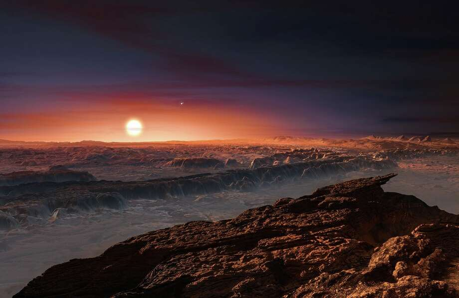 This artist's impression shows a view of the surface of the planet Proxima b orbiting the red dwarf star Proxima Centauri, the closest star to the Solar System. The double star Alpha Centauri AB also appears in the image to the upper-right of Proxima itself. Proxima b is a little more massive than the Earth and orbits in the habitable zone around Proxima Centauri, where the temperature is suitable for liquid water to exist on its surface. Photo: ESO/M. Kornmesser