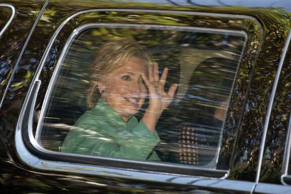 Hillary Clinton waves from her motorcade vehicle as she arrives for a fundraiser at the home of Justin Timberlake and Jessica Biel Tuesday. Like a gymnast on a balance beam, she manages to stay within the narrow parameters of lawfulness without losing her footing.