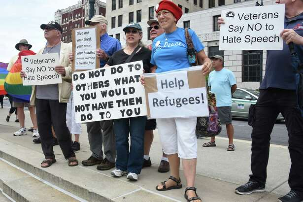 Members from Capital District Coalition Against Islamophobia, Capital Pride Center and other organizations host a counter protest at a Decision America Tour 2016 with Franklin Graham at West Capitol Park on Thursday, Aug. 25, 2016 in Albany, N.Y. Graham, the eldest son of Billy and Ruth Bell Graham, is traveling to all 50 states to hold prayer rallies, to preach the Gospel, and to challenge believers to take a stand and take action. He urged Christians to vote, to live out their faith in every part of their lives, and to pray for our nation. (Lori Van Buren / Times Union)