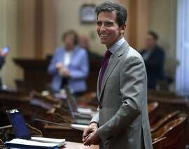 State Sen. Mark Leno attends a session on the senate floor at the State Capitol in Sacramento, Calif. on Aug. 25, 2016. It's a busy time of year in the halls of the State Capitol as both the Senate and Assembly wrap up their sessions.