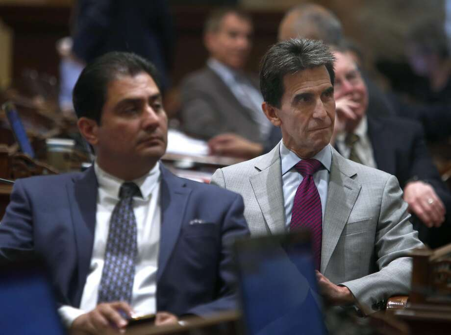 State Sen. Mark Leno (right) listens to a resolution read on the senate floor at the State Capitol in Sacramento, Calif. on Aug. 25, 2016. It's a busy time of year in the halls of the State Capitol as both the Senate and Assembly wrap up their sessions. Photo: Paul Chinn, The Chronicle