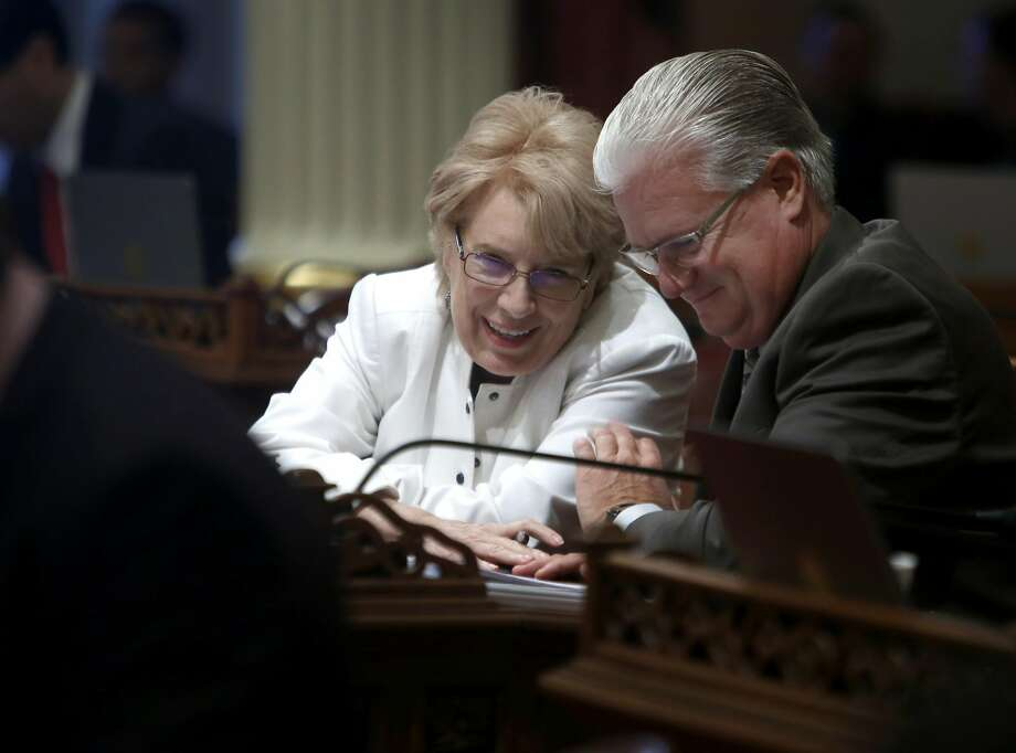 State Sen. Jean Fuller chats with Sen. Andy Vidak on the senate floor at the State Capitol in Sacramento, Calif. on Aug. 25, 2016. It's a busy time of year in the halls of the State Capitol as both the Senate and Assembly wrap up their sessions. Photo: Paul Chinn, The Chronicle
