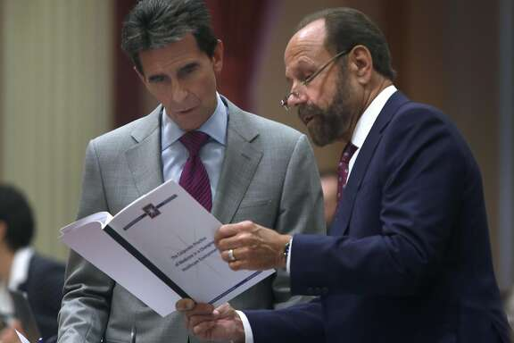 State Sen. Mark Leno studies a document with Sen. Jerry Hill at the State Capitol in Sacramento, Calif. on Aug. 25, 2016. It's a busy time of year in the halls of the State Capitol as both the Senate and Assembly wrap up their sessions.