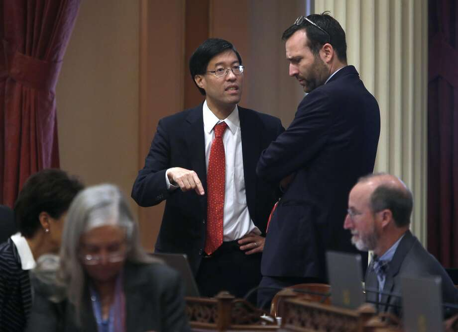 State Sen. Richard Pan confers with Sen. Benjamin Allen on the senate floor at the State Capitol in Sacramento, Calif. on Aug. 25, 2016. It's a busy time of year in the halls of the State Capitol as both the Senate and Assembly wrap up their sessions. Photo: Paul Chinn, The Chronicle